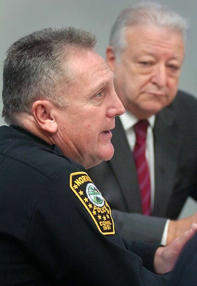 Norwalk police chief Harry Rilling and Mayor Richard Moccia hold a press conference Tuesday morning to address the weekend shooting at the Enigma Cafe on Van Zant St. Hour photo / Erik Trautmann