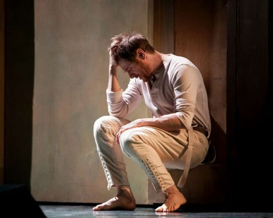 """Simon Keenlyside performs in the title role of """"Hamlet,"""" during the dress rehearsal Friday March 12, 2010, at the Metropolitan Opera in New York. (AP Photo/Metropolitan Opera, Marty Sohl)"""