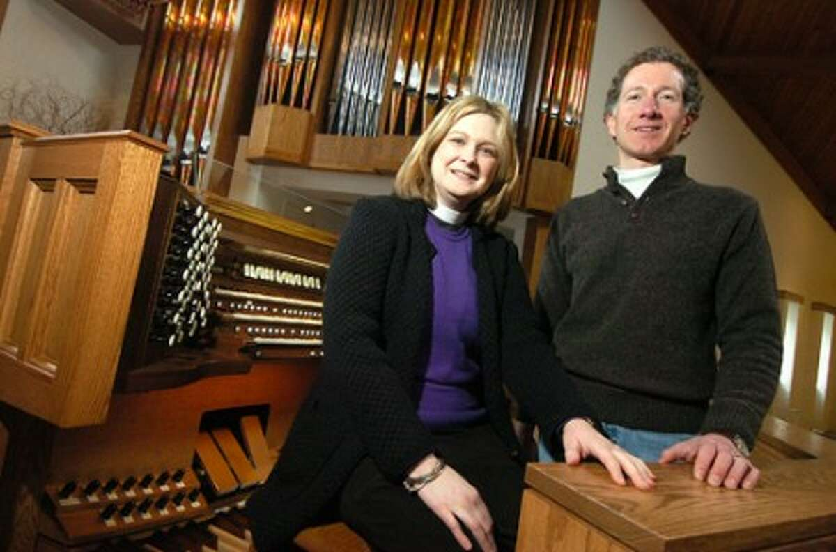 Photo/Alex von Kleydorff. The Reverend Mary Grace Williams, Rector at St. Matthews Episcopal Church and Organist Rodney Ayers with the churches new Pipe Organ and renovations finished.