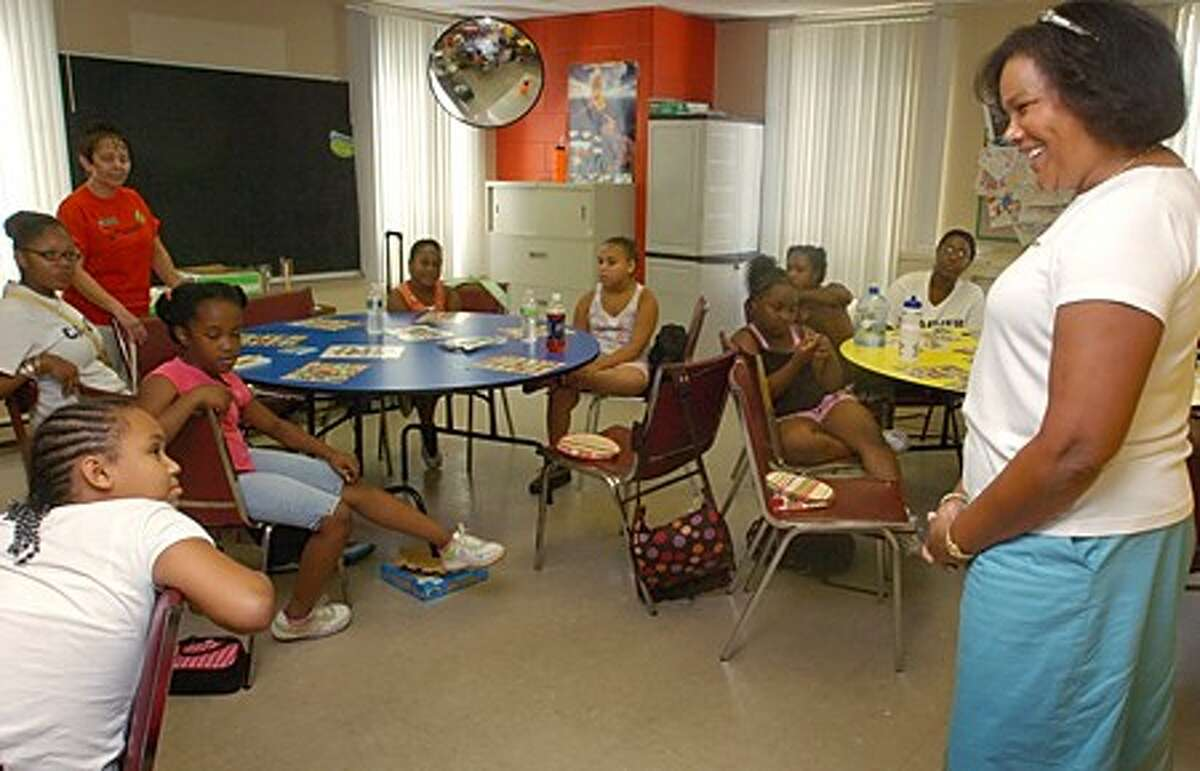 Jennifer Smith Turner, CEO of the Girl Scouts of Connecticut, talks with girls who participate in the weekly Girl Scout program at The George Washington Carver Communtiy Center Thursday. The program serves 43 girls at the Center between the ages of 9-13. Hour photo / Erik Trautmann