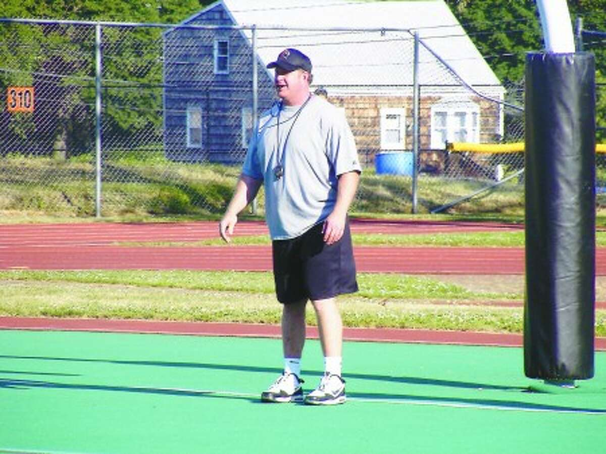 New Stamford High football head coach Bryan Hocter keeps on eye on things during a recent spring practice.