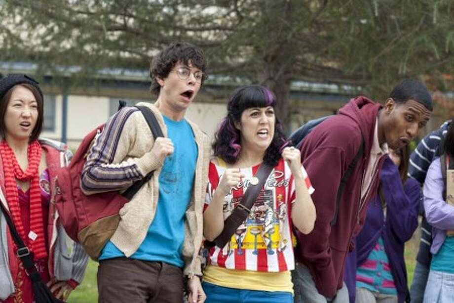"Paul Iacono, center left, and Kara Taitz, center right, are shown in a scene from the scripted comedy series, ""The Hard Times of RJ Berger,"" premiering Sunday, June 6, 2010 on MTV. (AP Photo/MTV)"