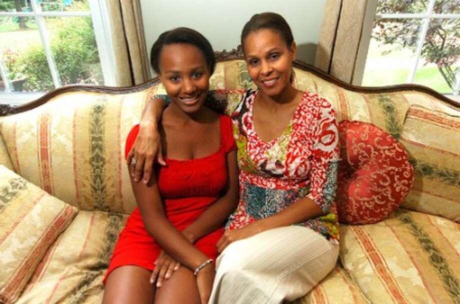 Photo/Alex von kleydorff. Ciara and mom Maria White, have returned from Uganda.