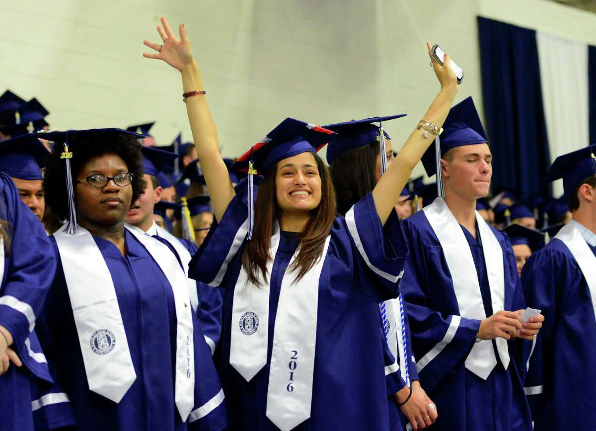 Graduate Kaylynne Mercado waves to her family during Staples High School's Class of 2016 Commencement Ceremony in Westport, Conn., on Friday June 17, 2016.