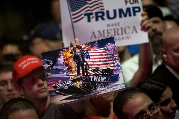 Trump-on-a-tank artwork in the crowd as  the presumptive Republican nominee spoke campaigned at Gilley�s Club in Dallas, June 16, 2016. Donald Trump�s campaign schedule is being driven by his fund-raising needs, prompting him to appear in heavily Republican states like Georgia and Texas and diverting his attention from battleground states where Hillary Clinton is spending her time. (Eric Thayer/The New York Times)