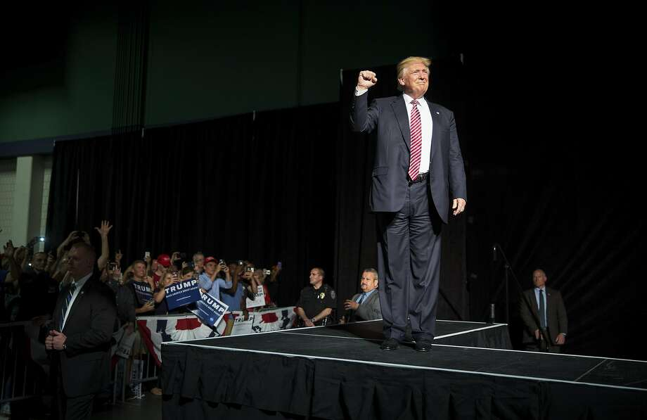 FILE -- Donald Trump, the presumptive Republican presidential nominee, takes the stage for a rally in Greensboro, N.C., June 14, 2016. Recent polls are showing that Trump's repeated calls for a ban on Muslims entering the United States, on the heels of the attack in Orlando, is not gaining traction among voters he will need in November. (Damon Winter/The New York Times) Photo: DAMON WINTER, NYT