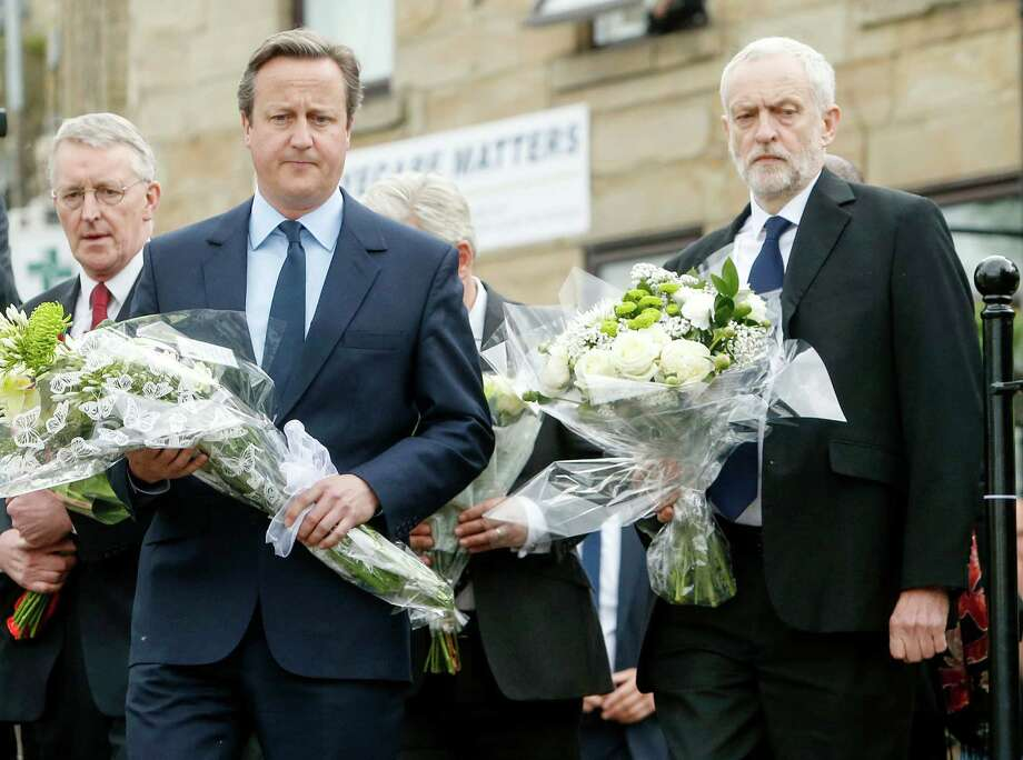 British Prime Minister David Cameron, center, and other UK political leaders prepare to lay floral tributes for slain lawmaker Jo Cox in Birstall. Photo: Danny Lawson, SUB / PA