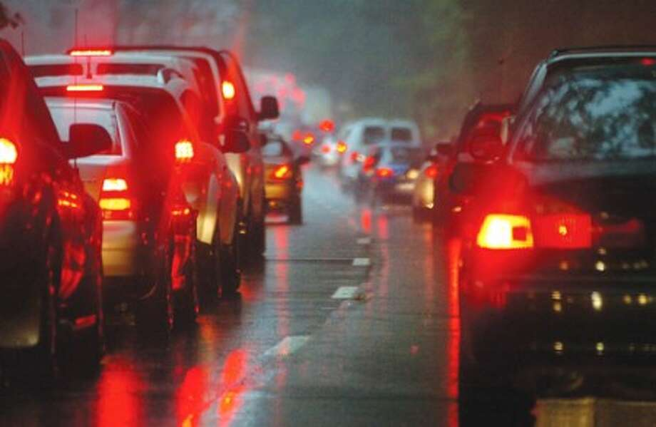 File Photo/Alex von Kleydorff. The familliar sight of brake lights during the morning rush hour''s on the Merritt Parkway in Westport