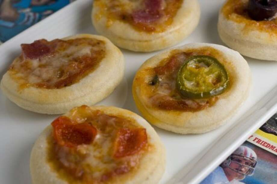This photo taken Jan. 24, 2010 shows bite sized pizza sliders which are prefect for a Super Bowl gathering. Prepared in advance they can be quickly baked in a hot oven as they are needed while the game plays out. (AP Photo/Larry Crowe)