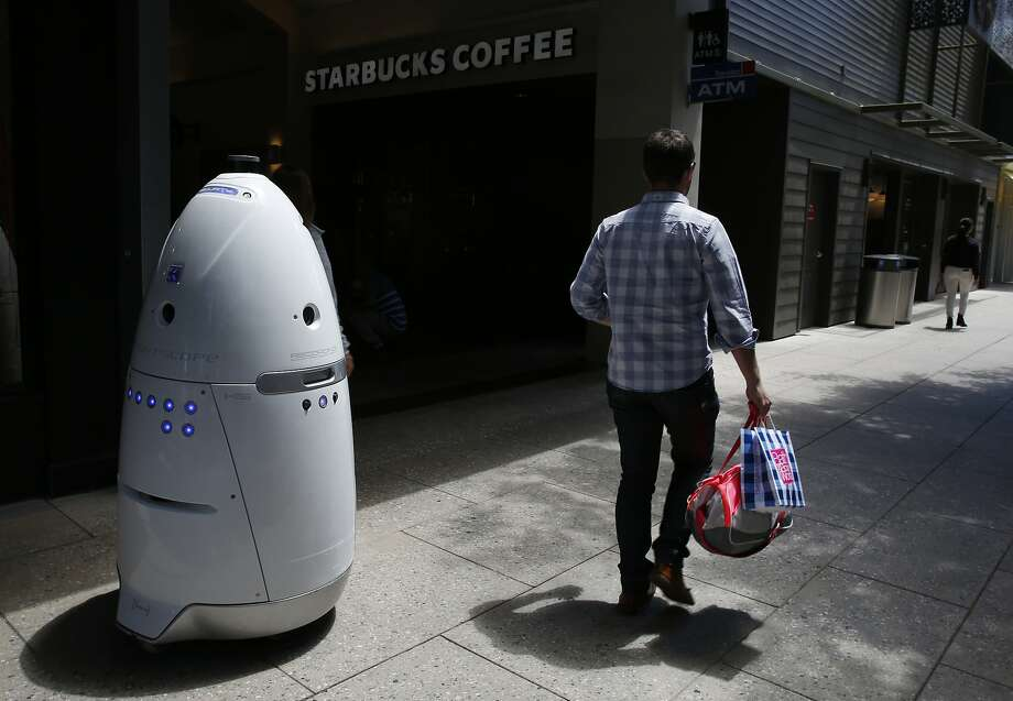 A Knightscope K5 autonomous security robot patrols Stanford Shop ping Center in Palo Alto. The robot is less jarring to many people than a guard with a gun. Photo: Leah Millis, The Chronicle