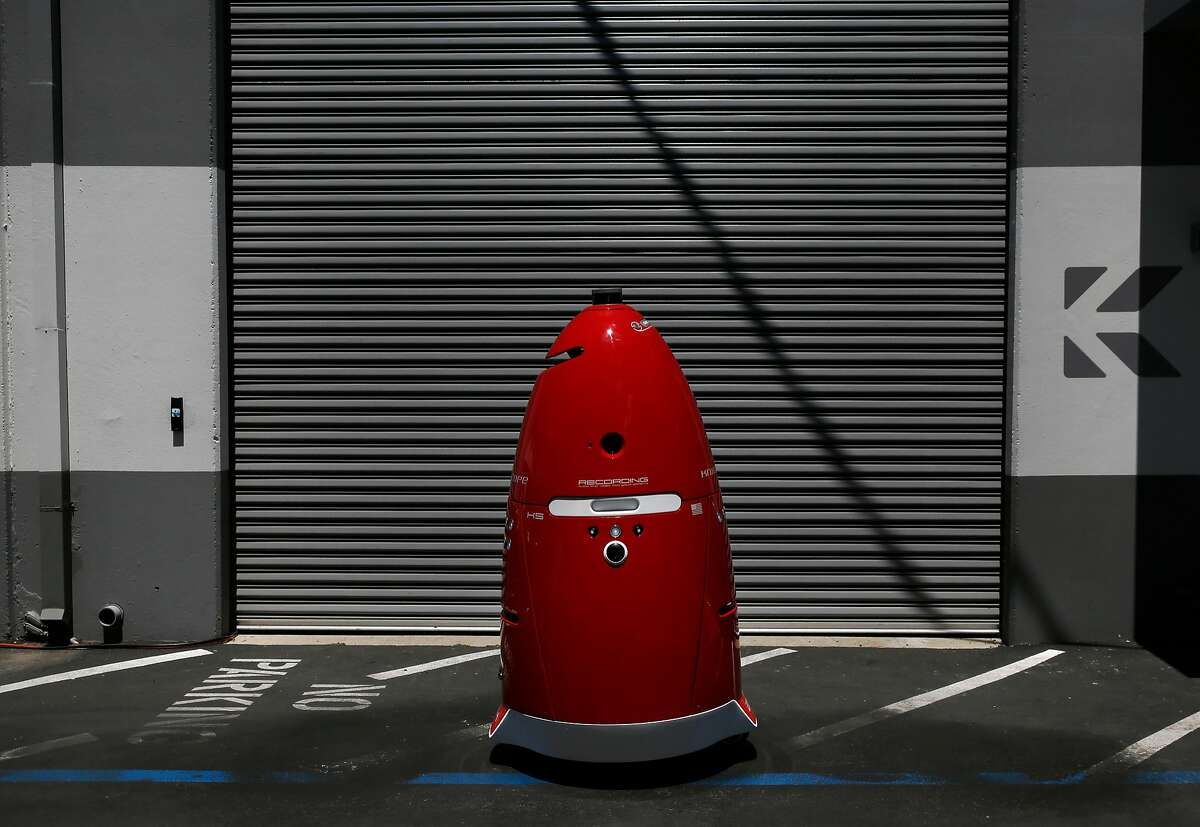 A Knightscope K5 autonomous security robot roams around outside of Knightscope's headquarters June 15, 2016 in Mountain View, Calif.