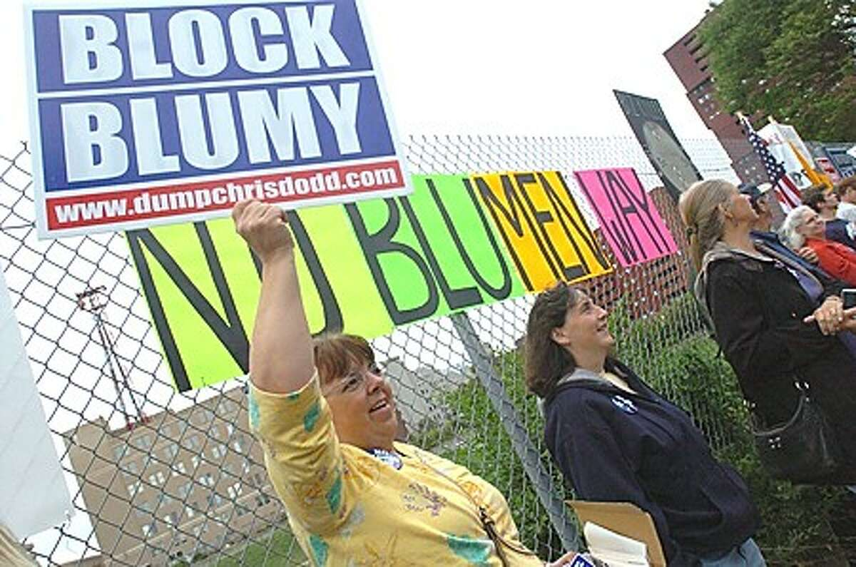 Mary Smutnick among the many protesters outside of the Stamford Marriott on Thursday where President Obama was attending a fundraiser for Richard Blumenthal. hour photo/matthew vinci