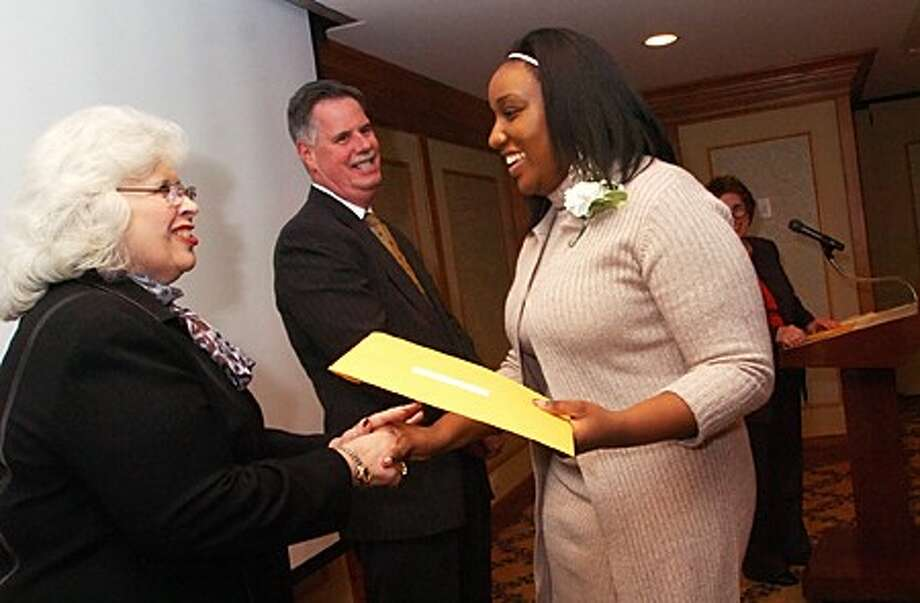 School to Career graduate Tharmalade Onesair receives her School To Career Scholarship from Donna Custer, President Norwalk Mentor Scholarship Fund and Ed Musante, President, Greater Norwalk Chamber of Commerce at the Graduation and Mentor Appreciation reception at the Norwalk Inn Thursday evening. Hour photo / Erik Trautmann