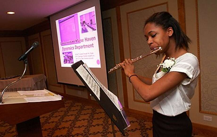 School to Career graduate performs during the School To Career Graduation and Mentor Appreciation reception at the Norwalk Inn Thursday evening. Hour photo / Erik Trautmann