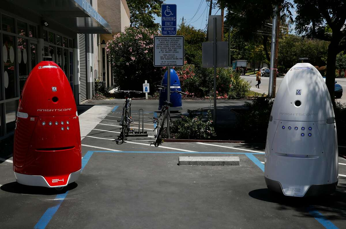 Knightscope's K5 autonomous security robots roam around outside of Knightscope's headquarters June 15, 2016 in Mountain View, Calif.