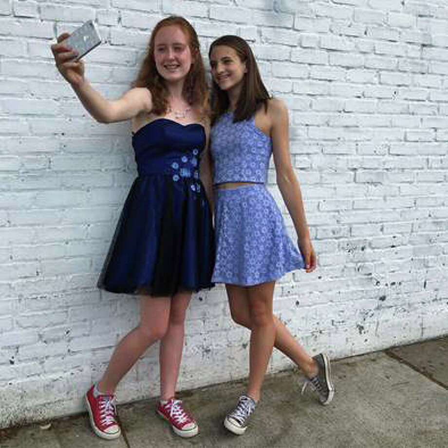 Maggie Tone and Carli Hedbabny, two Central Middle School students, are putting on a fashion show Saturday to benefit the National Eating Disorder Association. Photo: Contributed / Contributed Photo / Greenwich Time Contributed