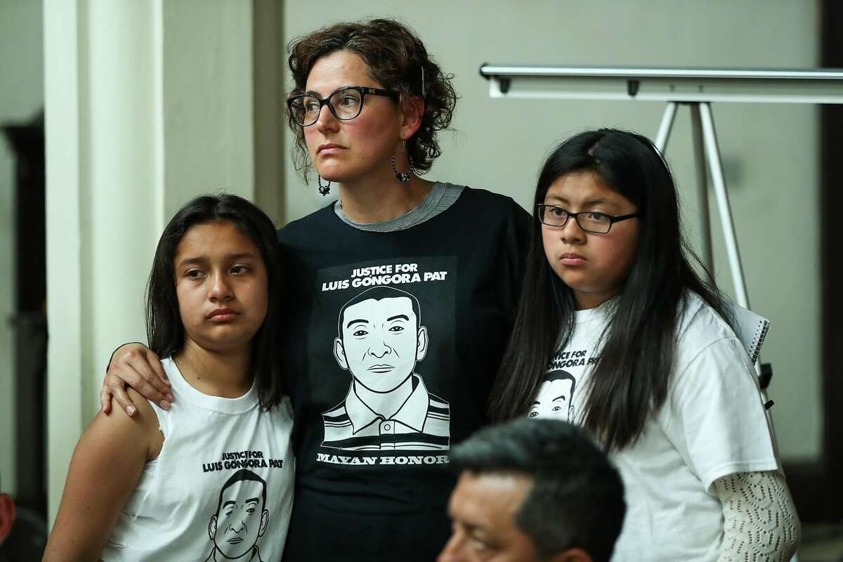 (left) Nadia Diaz, 11 and Evelyn Poot, 11 (right), both cousins of Luis Gongora Pat are comforted by Adriana Camarena (center) during a press conference announcing the filing of a claim against the city and county of San Francisco for the April 7, 2016 shooting and death of Luis Gongora Pat, in San Francisco, California, on Friday, June 17, 2016.