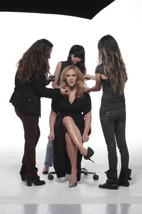 Amy Schumer, center, is styled by from left: makeup artist Fabiola Arancibia, stylist Danielle Nachmani and hair stylist Miok Donnelly in New York, April 11, 2013. Photo: TONY CENICOLA, New York Times