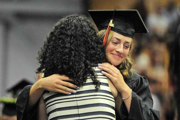 Alexandra Lucia Salazar gets a hug from her mother, Olga Anaya-Salazar after receiving her degree during the Ridgefield High School 2016 Commencement Exercise, Friday, June 17, 2016, at the O'Neill Center, Western Connecticut State University, Danbury, Conn. Anaya-Salazar is a teacher at RHS.
