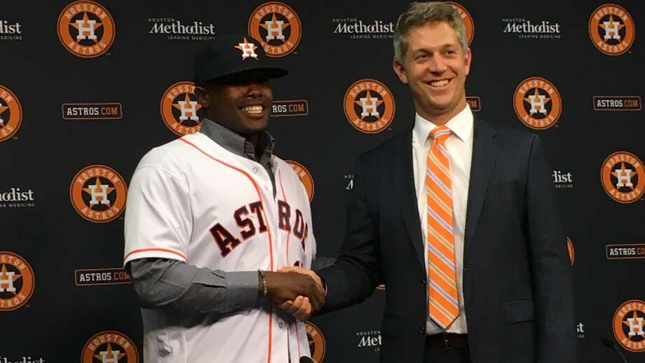 Second-round pick Ronnie Dawson shakes hands with Astros amateur scouting director Mike Elias. Photo: Jake Kaplan