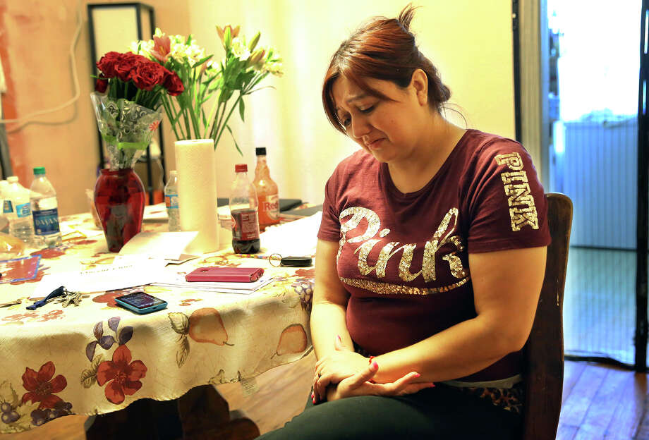 Chantell Fonseca grieves at home over the loss of her son Vincent Luna, 15, who was fatally injured while riding his bike. Photo: Tom Reel /San Antonio Express-News / 2016 SAN ANTONIO EXPRESS-NEWS