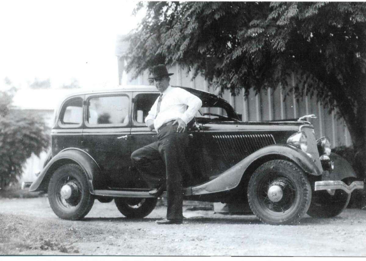 Legendary lawman Frank Hamer stands next to a 1934 Ford after he left the Texas Rangers.