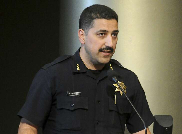 This July 16, 2013 photo shows Oakland Police Assistant Chief Paul Figueroa during a city council meeting in Oakland, Calif. Oakland Mayor Libby Schaaf removed interim police chief Ben Fairow on Wednesday, June 15, 2016, after appointing him less than a week ago amid a widening sex scandal involving several officers. Figueroa will serve as acting chief. (Doug Duran/Bay Area News Group via AP) MAGS OUT NO SALES