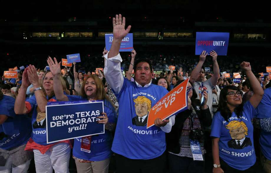 People attending the 2016 Texas Democratic Convention cheer as U.S. Rep. Joaquin Castro, D-San Antonio, (not pictured) speaks Friday June 17, 2016 at the Alamodome. Photo: Edward A. Ornelas, Staff / San Antonio Express-News / © 2016 San Antonio Express-News