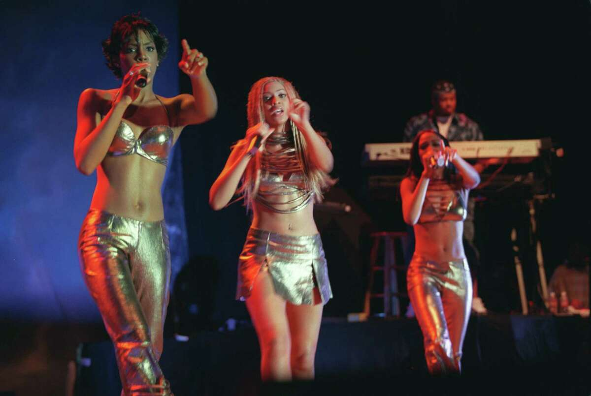 Destiny's Child, the Houston hip-hop harmony group, performed in front of a band for the first time at the Coca-Cola Southern Star Amphitheater at Six Flags AstroWorld July 31, 2000. From left, Kelly Roland, Beyonce Knowles and Michelle Williams, after the departure of short-timer Farrah Franklin. At the concert, they debuted their single for the Charlie's Angels movie soundtrack. Knowles said they chose to work with a band on stage because they wanted to move to the next level of performing.
