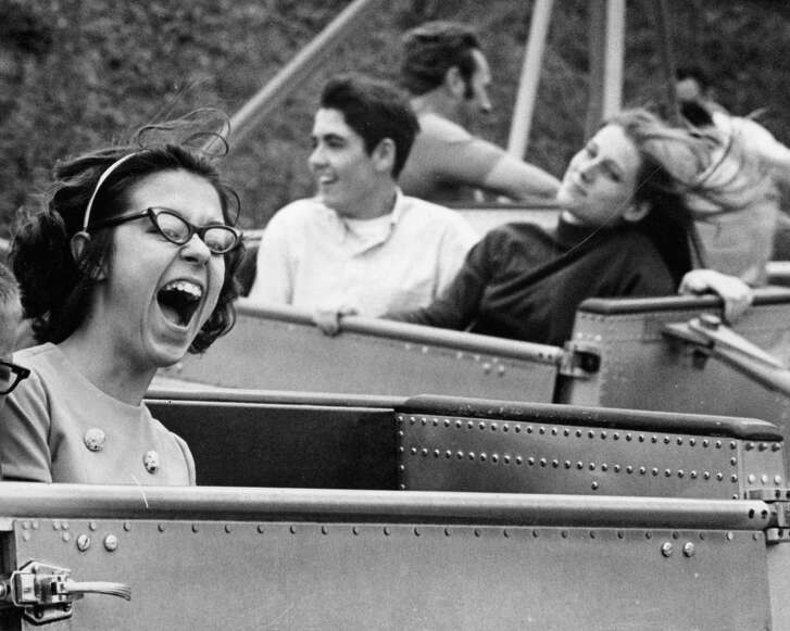 A young lady aboard the Astro Go-Go cries out in delight during Astroworld's opening season weekend, April 5, 1969. An 1895 carousel, new puppet show and a circus tent stage for clown shows are among the added attractions.