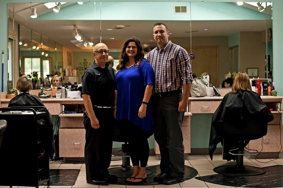 ERIN KIRKLAND | ekirkland@mdn.net From left, former owner Nathan Torres and current owners Krystal and Jeff Zienert pose for a photo on Wednesday at Nathan's Hair Unlimited. The salon recently celebrated its 40th anniversary.