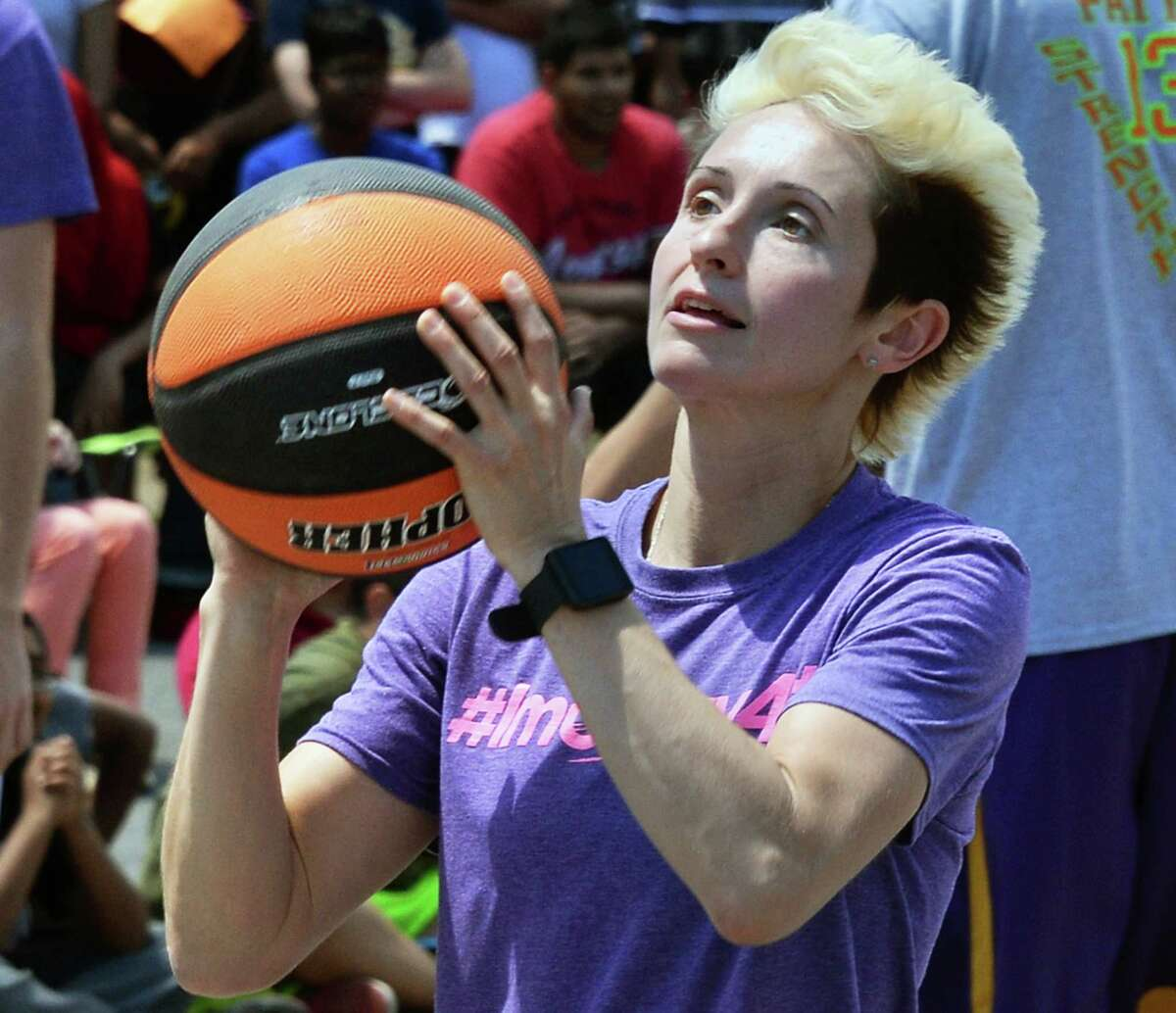Julie McBride, a former Mechanicville HS hoops star puts on a show for Martin Luther King School students Friday June 17, 2016 in Schenectady, NY. (John Carl D'Annibale / Times Union)
