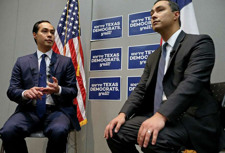 Secretary of Housing and Urban Development and former San Antonio mayor Julian Castro (left) and his twin brother U.S. Rep. Joaquin Castro, D-San Antonio, answer questions from the media at a press conference during the 2016 Texas Democratic Convention held Friday June 17, 2016 at the Alamodome. Photo: Edward A. Ornelas, Staff / San Antonio Express-News / © 2016 San Antonio Express-News