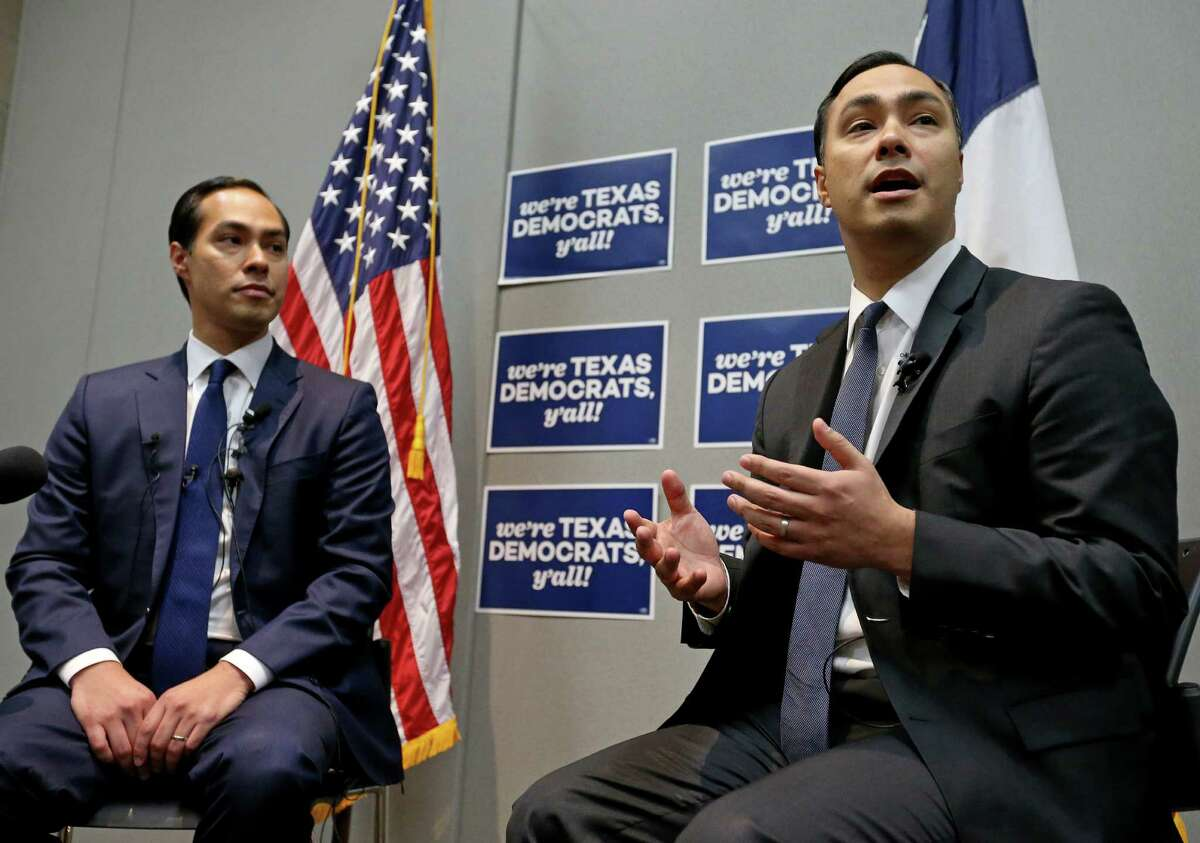 Secretary of Housing and Urban Development and former San Antonio mayor Julian Castro (left) and his twin brother U.S. Rep. Joaquin Castro, D-San Antonio, answer questions from the media at a press conference during the 2016 Texas Democratic Convention held Friday June 17, 2016 at the Alamodome.