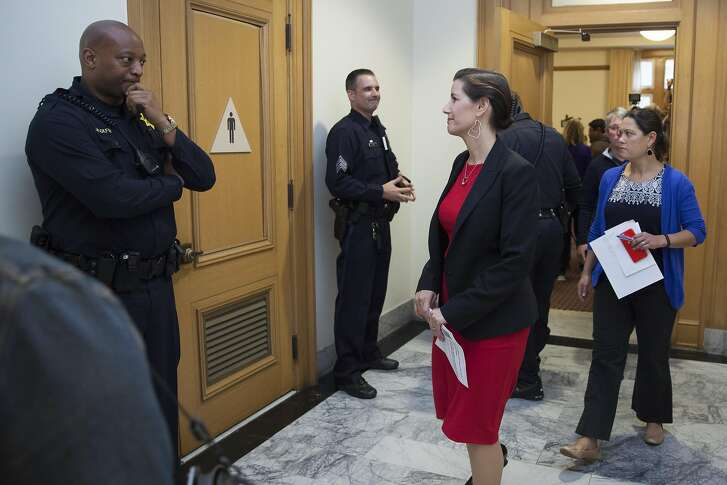 Oakland Mayor Libby Schaaf glances over to Oakland Police Officer Hookfin as she exits a meeting room followed by City Administrator Sabrina Landreth who was recently appointmented to over see the Oakland Police department during a press conference at City Hall in Oakland, California, USA 17 Jun 2016. (Peter DaSilva/Special to The Chronicle)