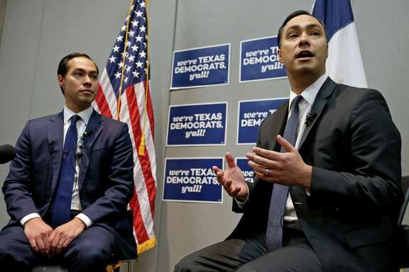 Secretary of Housing and Urban Development and former San Antonio Mayor Julián Castro, left, and his twin brother U.S. Rep. Joaquin Castro answer questions Friday during the 2016 Texas Democratic Convention. Each is uncertain about his future beyond the election.