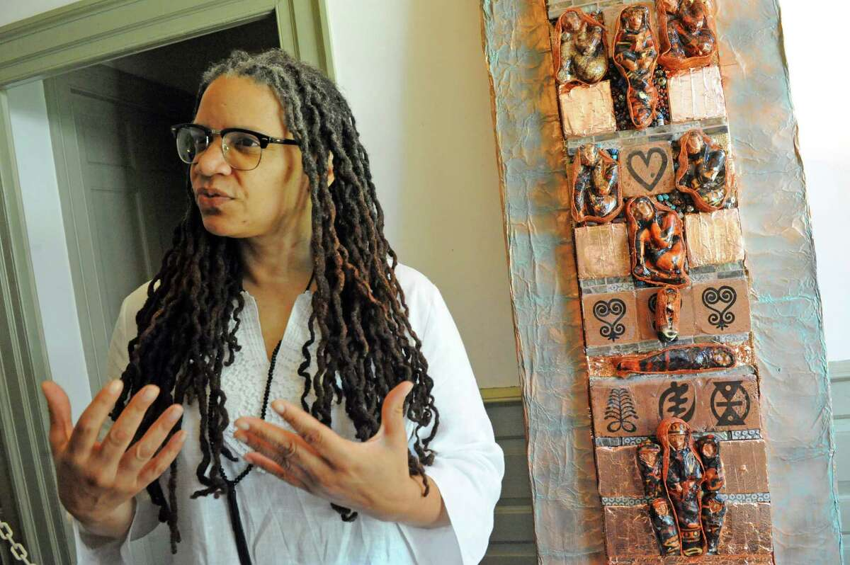 Artist Doris McCullough with her piece entitled, The Free Wall, at the Schuyler Mansion Historic Site on Friday June 17, 2016 in Albany, N.Y. (Michael P. Farrell/Times Union)