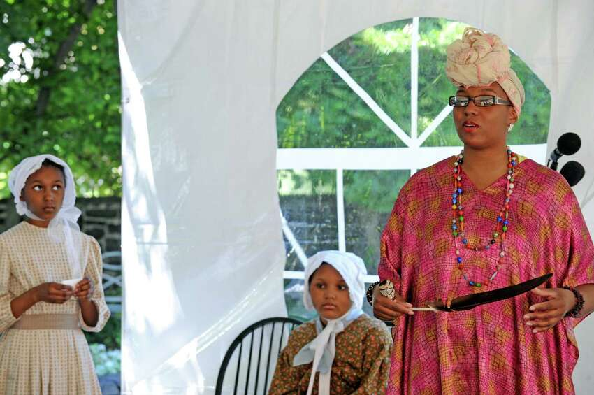 Thearse McCalmon, right, leads a talk on the Native and African American historic conection as Schuyler Flats slaves lay state in ossuaries at the Schuyler Mansion Historic Site on Friday June 17, 2016 in Albany, N.Y. (Michael P. Farrell/Times Union)