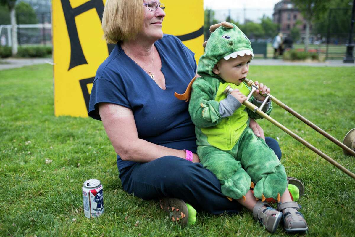 Beowulf Patton, 1, and his grandmother Melody Pieperburg watch as Environmental Encroachment perform.