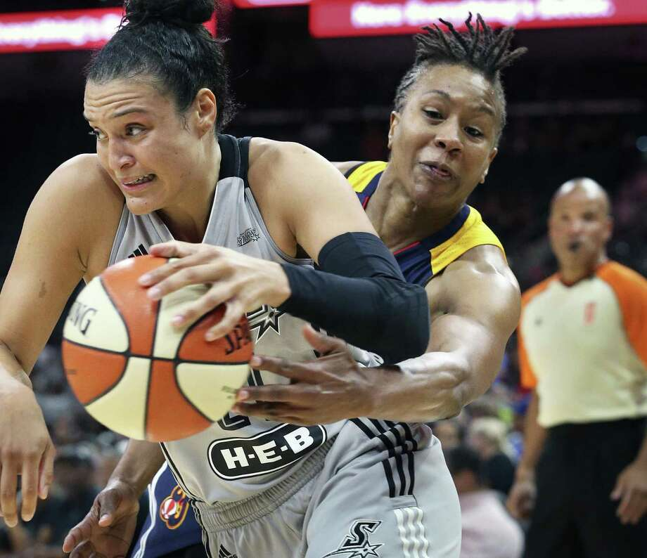 Guard Kayla McBride breaks to the lane as Tamika Catchings tries to steal the ball out of the view of the referee as the Stars host the Indiana Fever at the AT&T Center on June 17, 2016. Photo: TOM REEL, STAFF / SAN ANTONIO EXPRESS-NEWS / 2016 SAN ANTONIO EXPRESS-NEWS