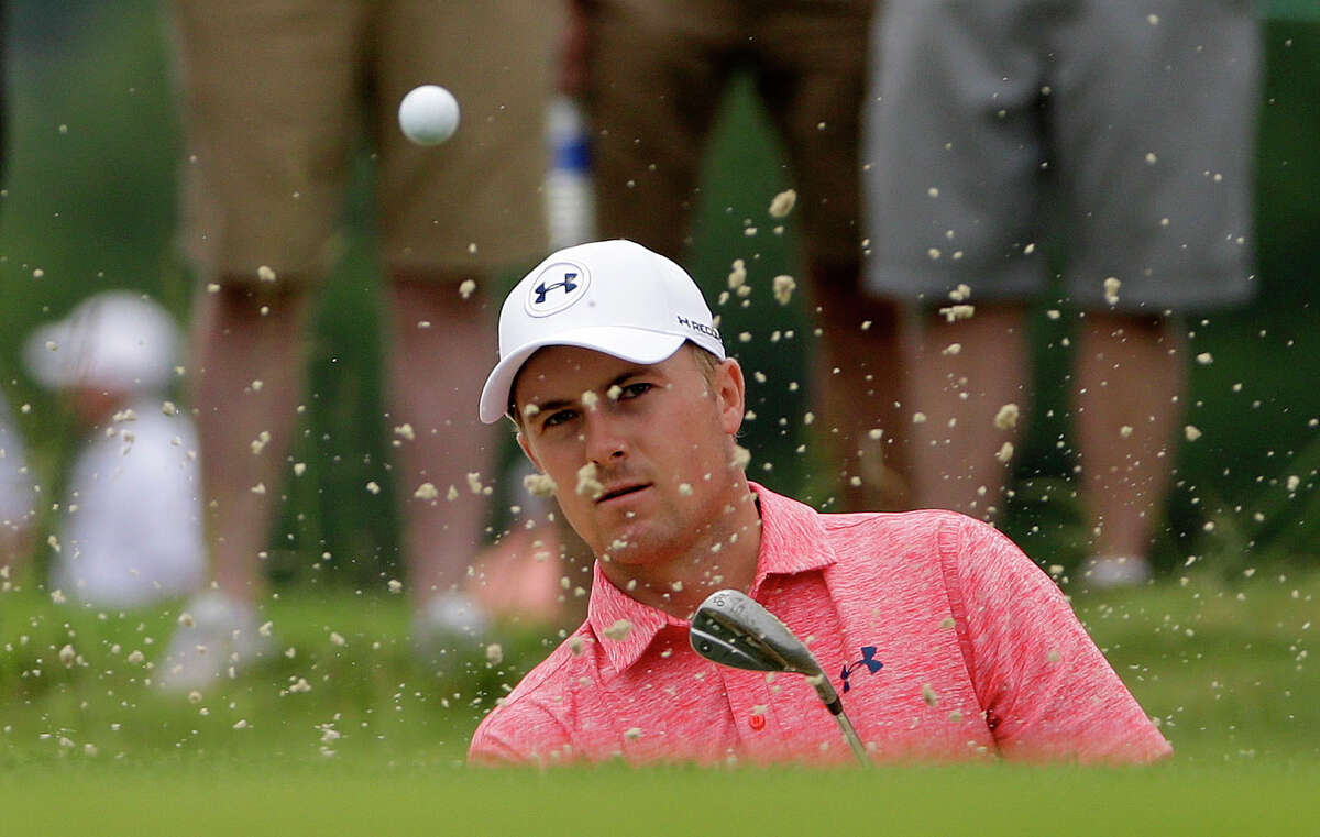 Defending champion Jordan Spieth wrapped up his rain-delayed first round early Friday morning, shooting a 2-over 72 that included five bogeys and two birdies.