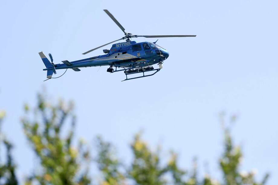 A San Antonio Police Department helicopter seen in 2016. A Schertz man has pleaded guilty to aiming a laser pointer at an SAPD helicopter in February, which temporarily blinded the pilot. Photo: Marvin Pfeiffer /San Antonio Express-News / Express-News 2016