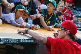 OAKLAND, CA - JUNE 17:  Tim Lincecum #55 of the Los Angeles Angels of Anaheim signs autographs outside the dugout before the game against the Oakland Athletics at the Oakland Coliseum on June 17, 2016 in Oakland, California. (Photo by Jason O. Watson/Getty Images)