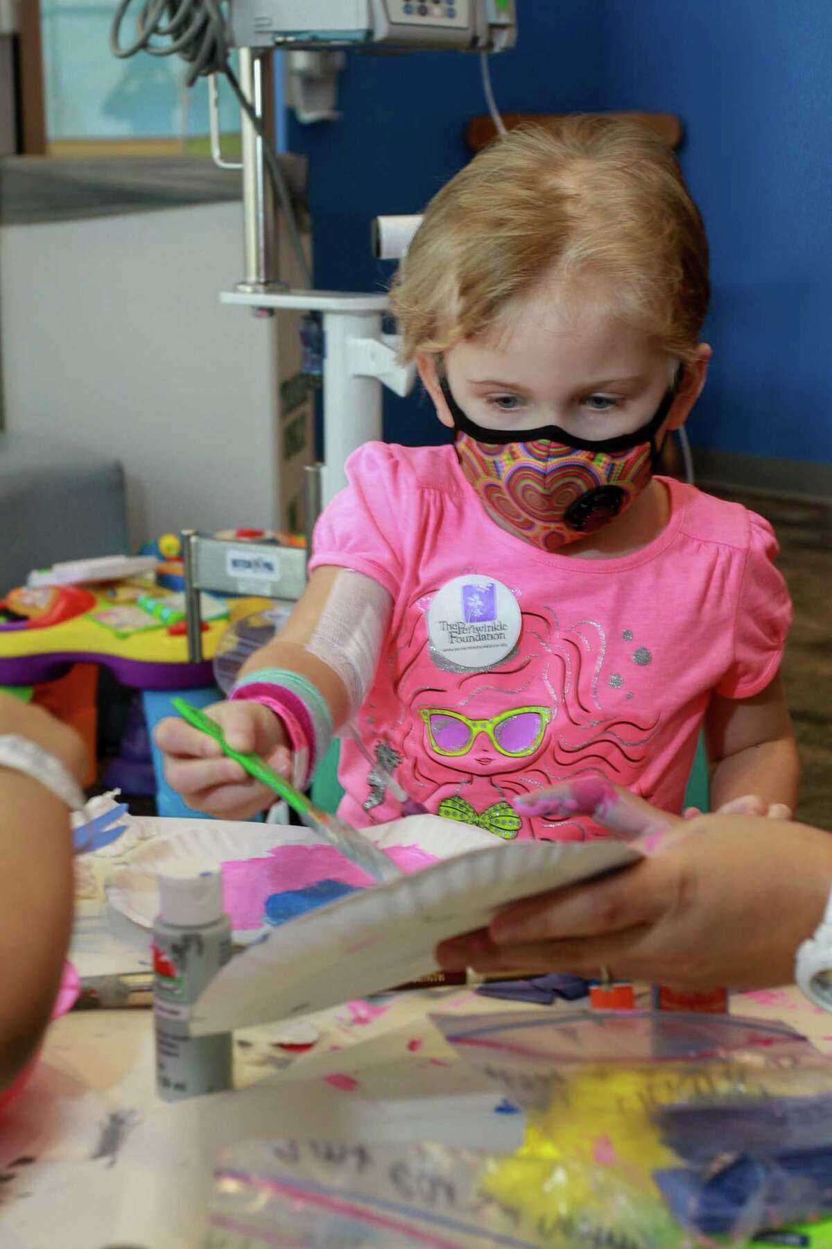 Evie Reed, 5, doing Animal Arts and Crafts at Camp Periwinkle Days. Camp Periwinkle Days transforms the Texas Children's Cancer and Hematology Centers waiting rooms into a two-day camp with games, prizes and activities to enrich the lives of some 500 children challenged by cancer under care at the hospital in Houston on June 17, 2016.