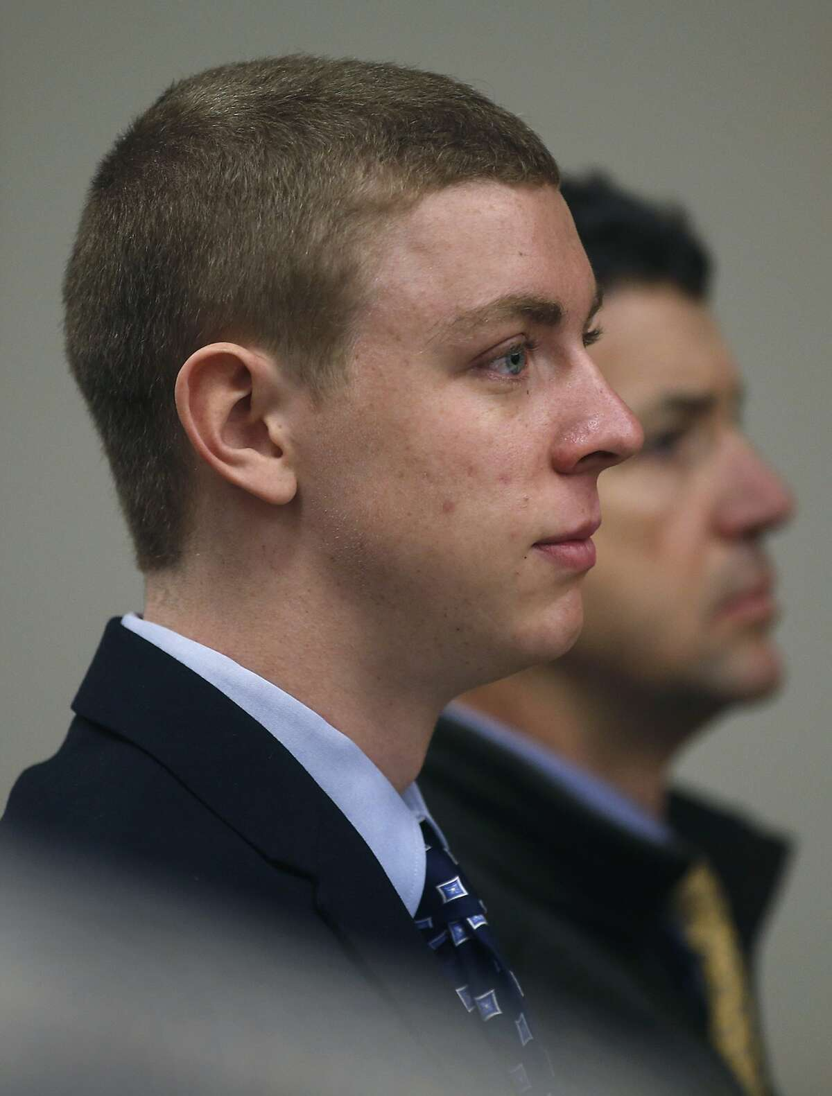 In this Feb. 2, 2015 file photo, accompanied by his father Dan Turner, right, former Stanford swimmer Brock Turner appears in a Palo Alto, Calif., courtroom.