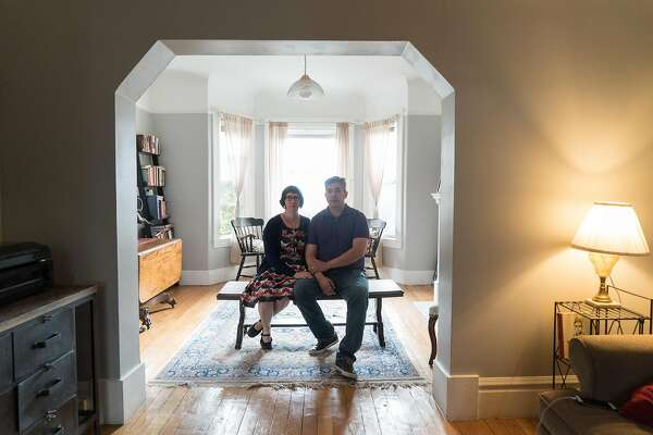 Brian and Sarah Grzybowski pose for a photo in their Potrero Hill apartment in San Francisco, Calif. on Saturday, June 18, 2016. The Grzybowski's rented a home for five years until their landlord evicted them last year.