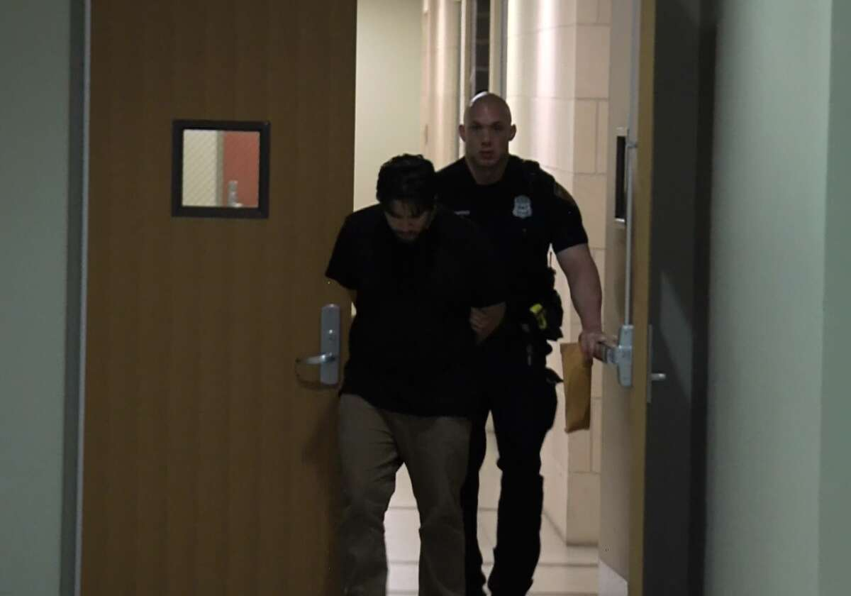 Peter Louis Gonzalez is led away by San Antonio police after being arrested in connection with the June 1 shooting death of 7-year-old Iris Rodriguez.