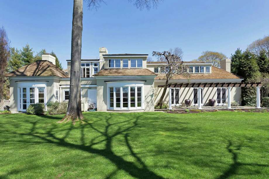 Tucked at the end of Althea Lane, this Mediterranean-style retreat sits on a private, 1.5 acres lush with flowering gardens, stone terraces and pergolas that back up to the Wee Burn Country Club. Photo: Contributed Photos / Darien News