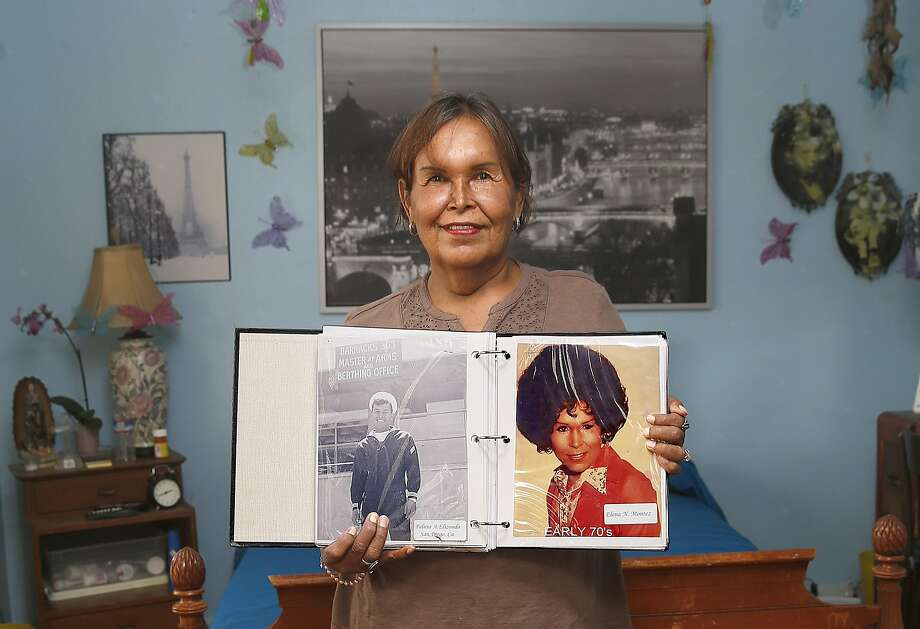 Felicia Elizondo shows her photo album where she was in Coronado in the navy during the sixties. Photo: Liz Hafalia, The Chronicle