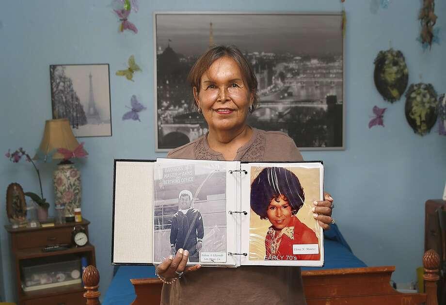 Felicia Elizondo shows her photo album where she was in Coronado in the navy during the sixties. Photo: Liz Hafalia, The Chronicle